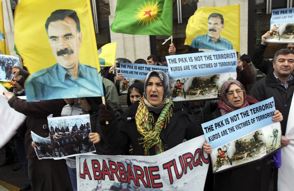 Kurdish demonstrators shout slogans and hold flags with portraits of jailed PKK leader Ocalan during a protest
