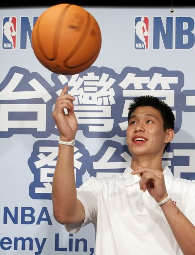 NBA player Lin of the Golden State Warriors poses for the media during a news conference in Taipei