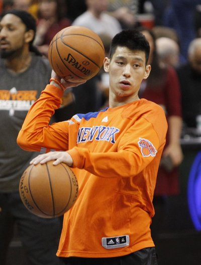 New York Knicks guard Jeremy Lin shoots baskets during warm-up before the start of game against Timberwolves in Minneapolis