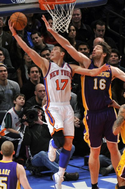 New York Knicks Jeremy Lin makes layup past Los Angeles Lakers Pau Gasol in NBA game in New York