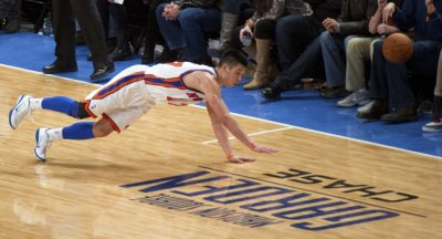 New York Knicks039 guard Lin dives for a ball out of bounds playing Los Angeles Lakers in NBA game in New York