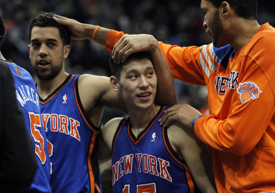 New York Knicks039 Lin is congratulated by teammates Jordan and Fields after win against Timberwolves in Minneapolis