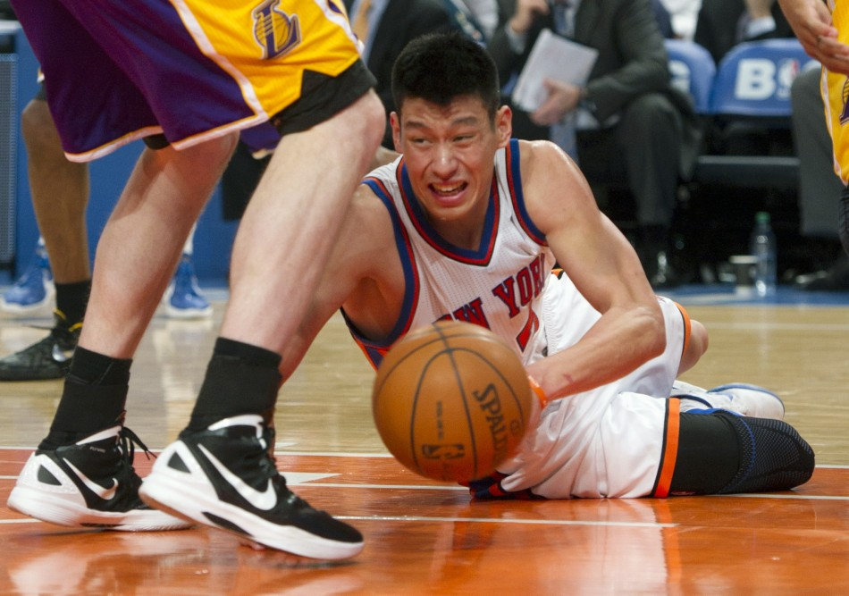 New York Knicks point Jeremy Lin controls loose ball against Los Angeles Lakers in NBA game in New York