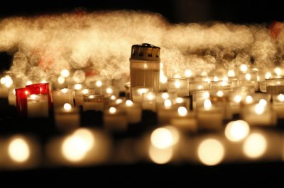 People light candles in front of the Frauenkirche Church of Our Lady in Dresden
