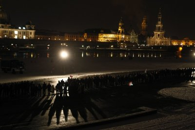 People build a human chain at the river Elbe in Dresden to protest against an Ultra-right activists march through the city centre