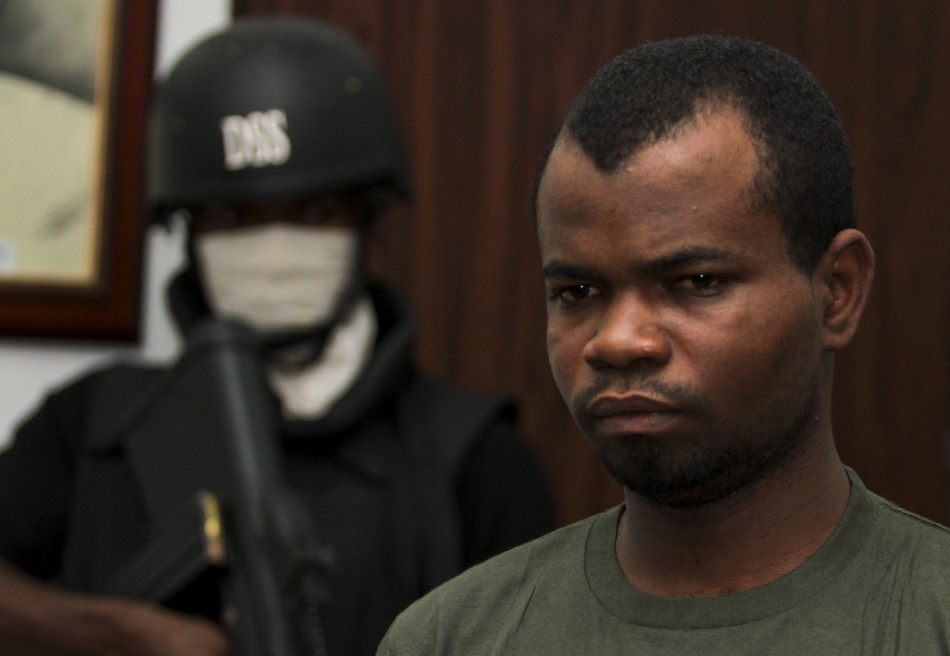 Bombing suspect Sokoto is guarded by a security official inside the state security service office in the capital Abuja