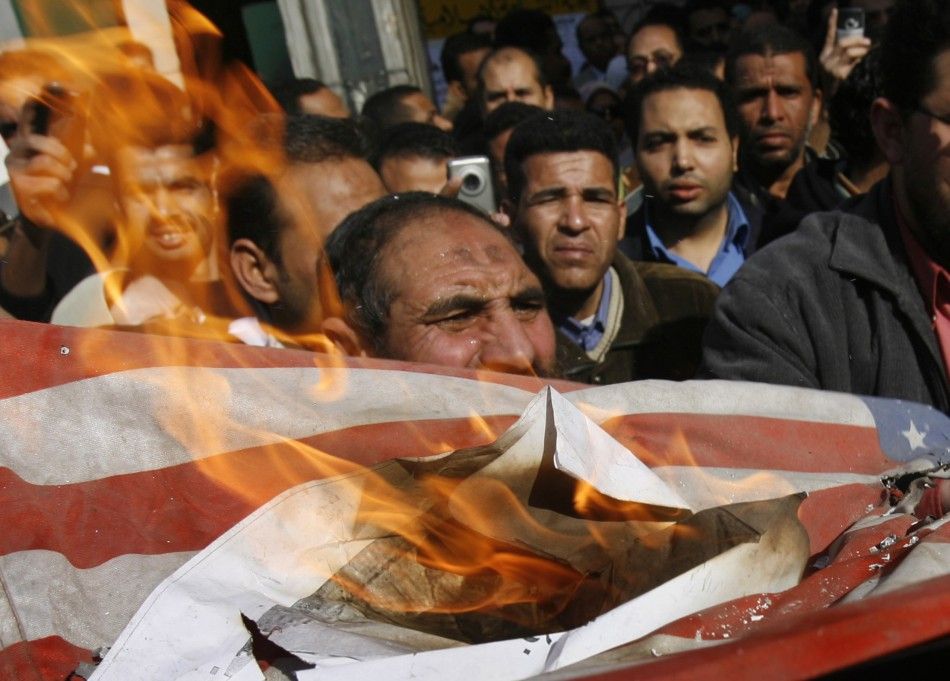 Egyptian demonstrators burn a U.S. flag
