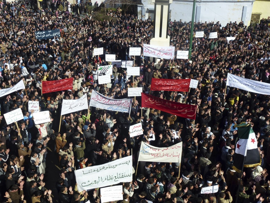 Demonstrators gather during a protest against Syria's President Bashar al-Assad, in Hula, near Homs