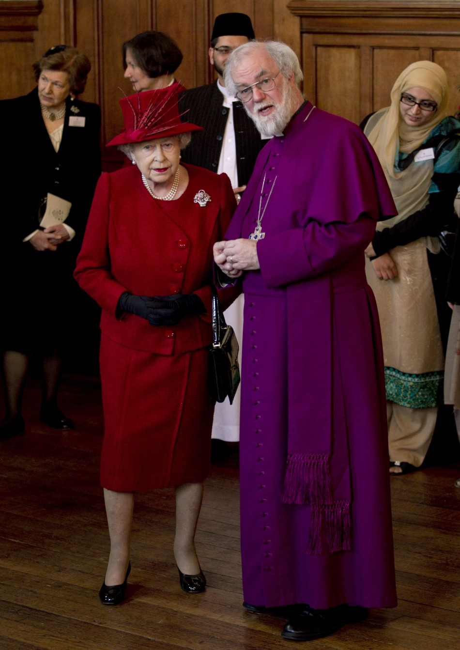 Britain's Queen Elizabeth speaks with the Archbishop of Canterbury, Rowan Williams during a multi-faith reception to mark the Queen's Diamond Jubilee at Lambeth Palace in London February 15, 2012.