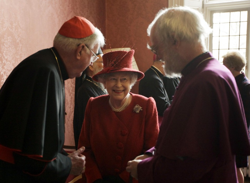 Britain's Queen Elizabeth speaks with the Archbishop of Canterbury Rowan Williams (R), and Cardinal Cormac Murphy-O'Connor as they attend a multi-faith reception to mark the Queen's Diamond Jubilee at Lambeth Palace in London February 15, 2012.
