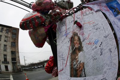 Part of a makeshift memorial for the late singer Whitney Houston is seen in Newark