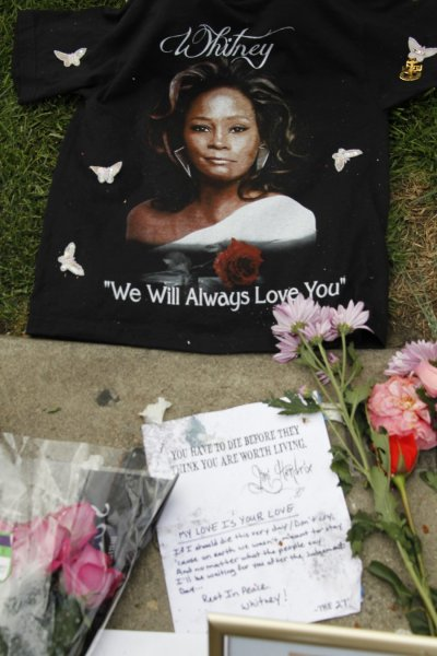 A T-shirt and a note left by a fan is pictured at a makeshift memorial to singer Whitney Houston at a corner of the Beverly Hilton Hotel in Beverly Hills