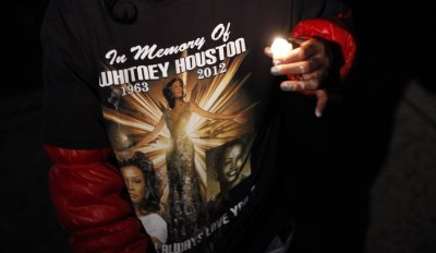A fan wears a T-shirt with an image of pop singer Whitney Houston outside the Whigham funeral home in Newark