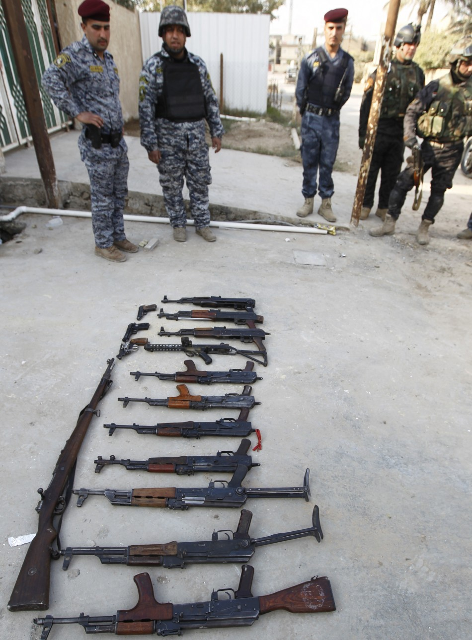 Weapons confiscated by Iraqi policemen in Baghdad