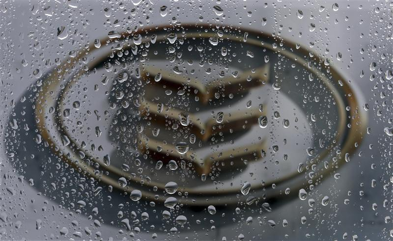 The Bank of Ireland logo is seen through raindrops on a window in Dublin