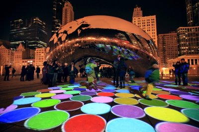 People examine quotLuminous Fieldquot a sound and video show projected at Cloud Gate, also known as quotThe Beanquot in Millennium Park in Chicago