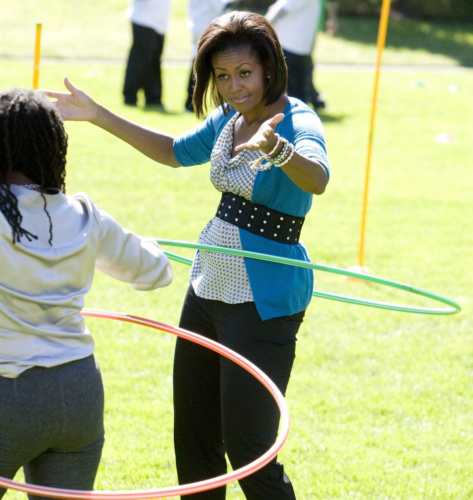 U.S. first lady Michelle Obama hula hoops at Healthy Kids Fair on South Lawn of the White House in Washington