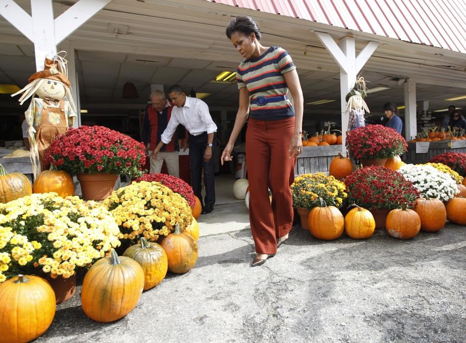 U.S. President Barack Obama and first lady Michelle Obama pick pumpkins in Hampton