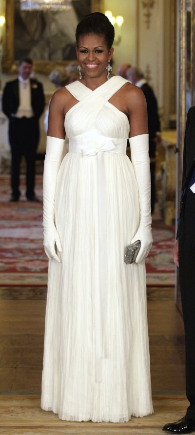 U.S first lady Michelle Obama poses for a photograph before a State Dinner at Buckingham Palace in London