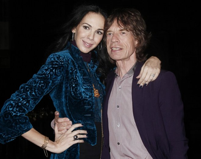 Musician Mick Jagger and designer L'Wren Scott pose following her Fall/Winter 2012 collection during New York Fashion Week, February 16, 2012.
