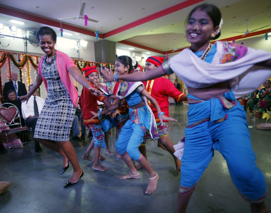 U.S. first lady Michelle Obama dances at the Holy Name High School in Mumbai