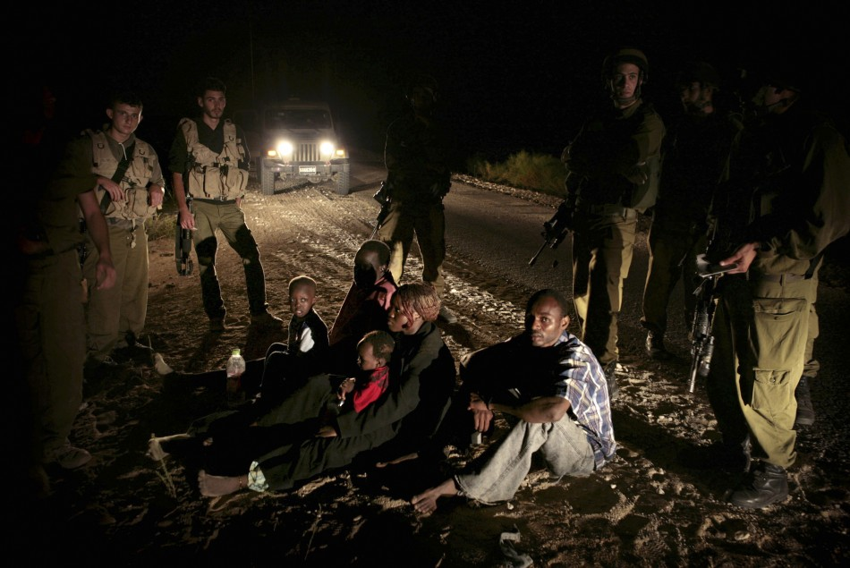 Sudanese refugees who crossed into Israel illegally are detained near Nitzana