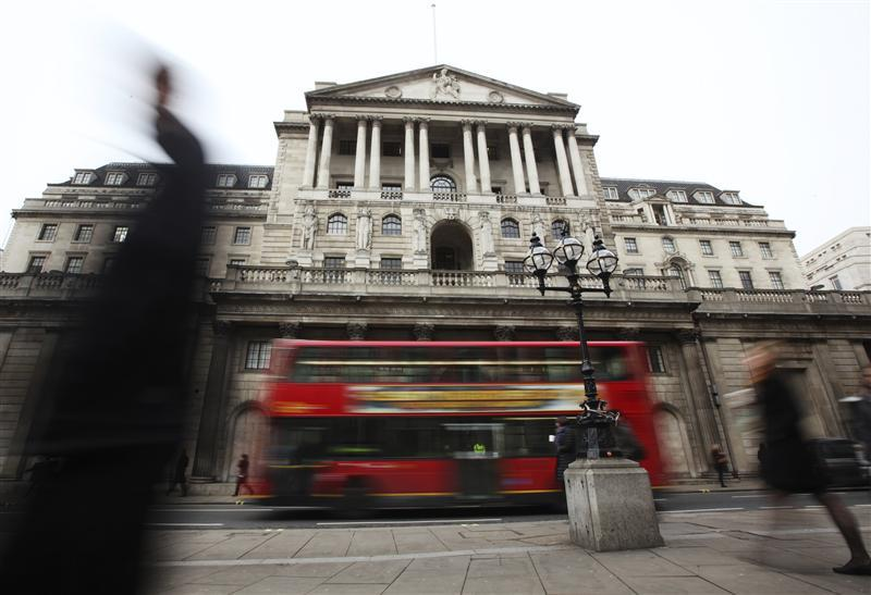 Pedestrians pass The Bank of England in the City of London