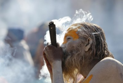 Hindu holy man smokes marijuana