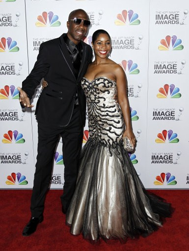 Actor JB Smoove, left, and wife Shahidah Omar