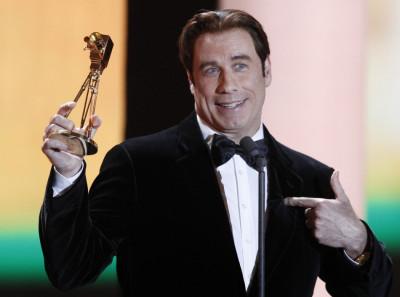 U.S.actor John Travolta receives the award for best international actor