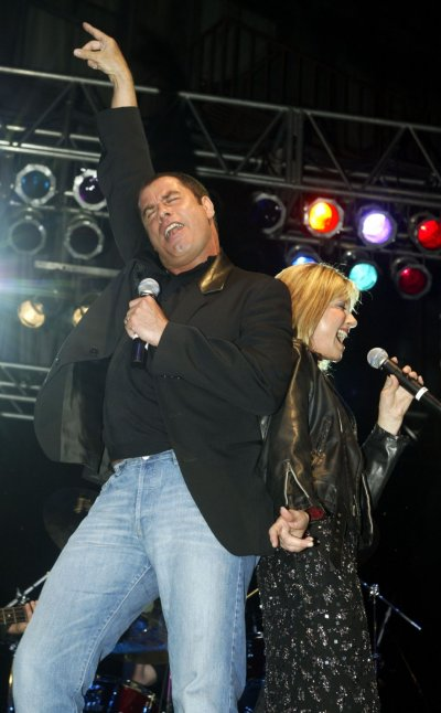 Actor John Travolta L and Australian singer Olivia Newton-John perform a song