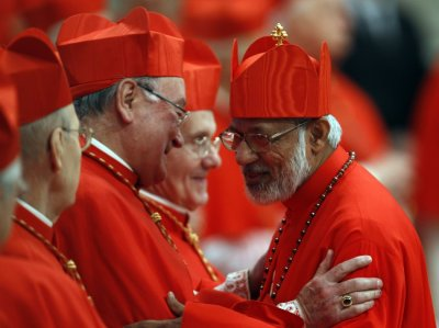 New Cardinal George Alencherry R of India talks with Cardinal Timothy Dolan R of the U.S. during a consistory ceremony in Saint Peter039s Basilica