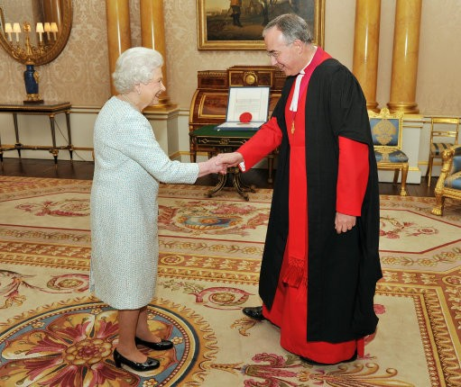 Queen Elizabeth II shakes hands with the Dean of Westminster Abbey Dr John Hal
