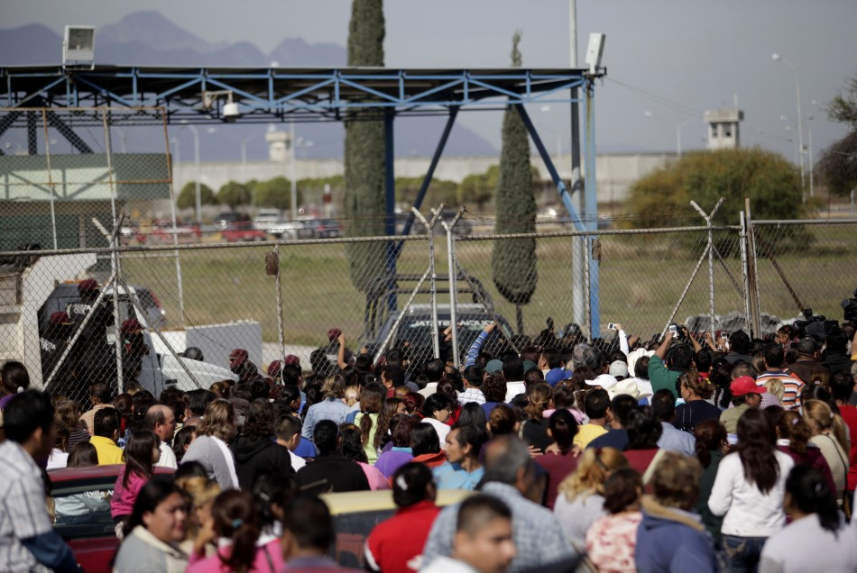 Relatives of inmates wait for news of their relatives outside the state prison in Apodaca