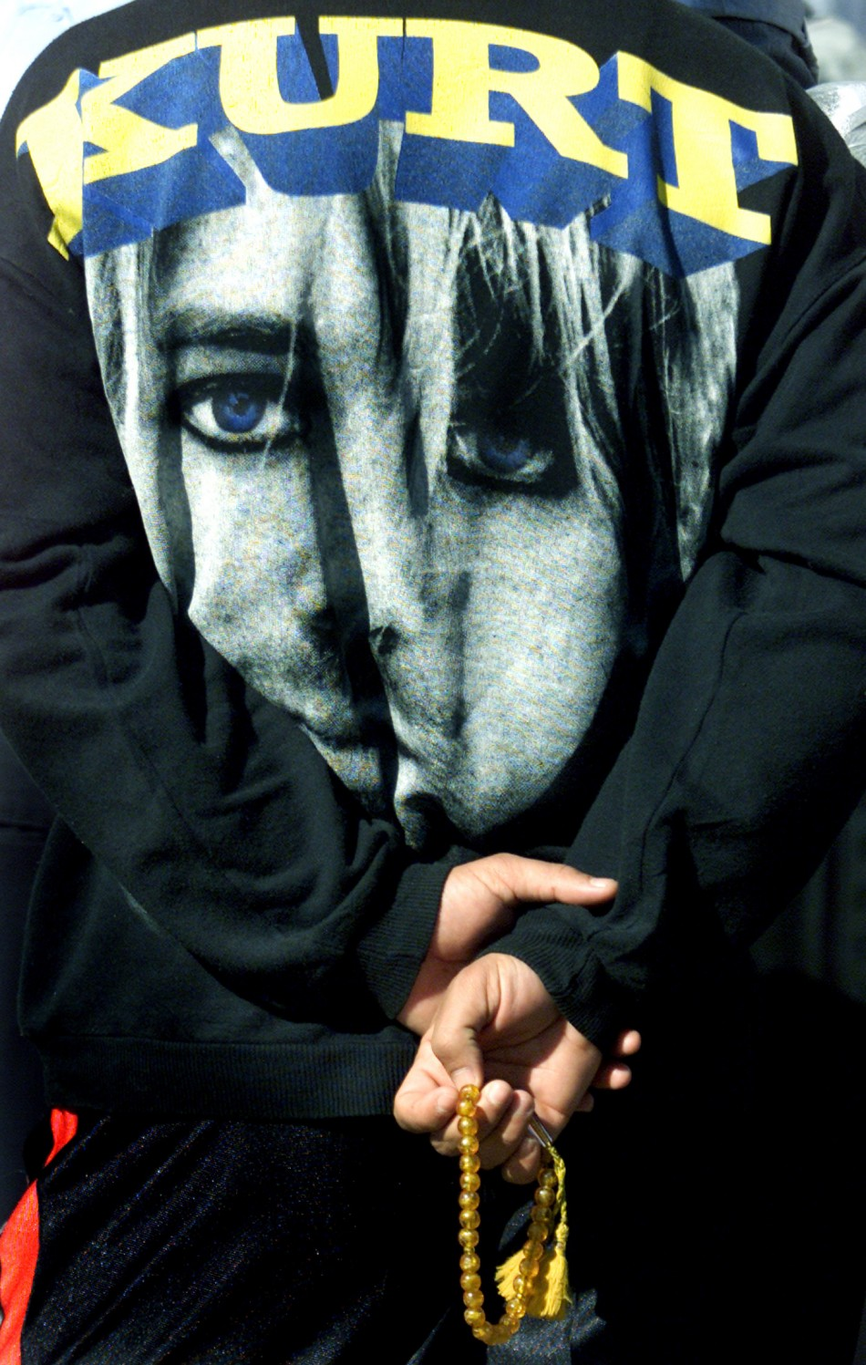 An Iraqi policeman, wearing a shirt emblazoned with a picture of the rock band Nirvanas late frontman Kurt Cobain