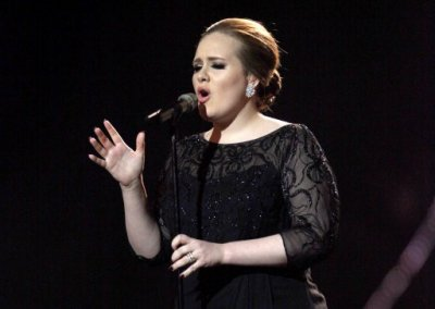 Adele performs on stage during the Brit Awards 2011