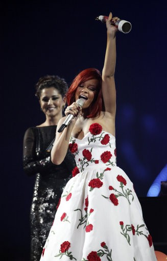 Rihanna collects her award for International Female from Cheryl Cole on stage during the 2011 Brit Awards at the O2 Arena, London.