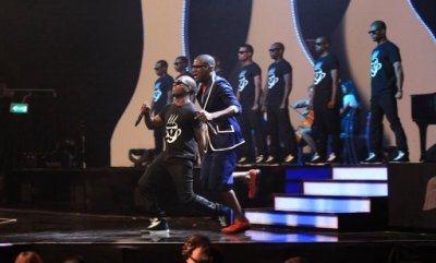 Tinie Tempah and Labrinth perform on stage during the 2011 Brit Awards at the O2 Arena, London.
