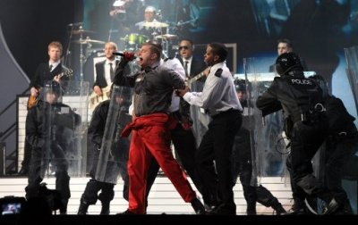Plan B performs on stage during the 2011 Brit Awards at the O2 Arena, London.