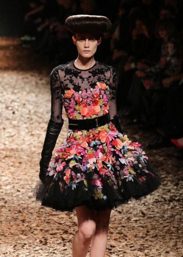 A model wearing a black tulle dress
