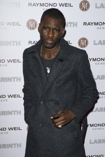 Wretch 32 arrives for the Pre-Brit Awards Dinner at a London venue, Thursday, Jan. 26, 2012.
