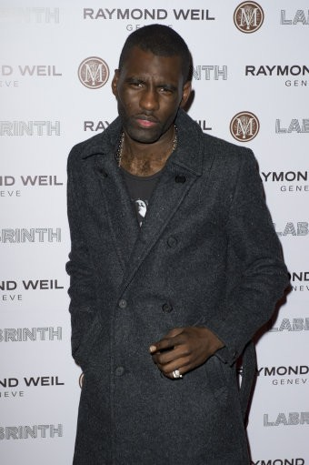 Wretch 32 arrives for the Pre-Brit Awards Dinner at a London venue, Thursday, Jan. 26, 2012.