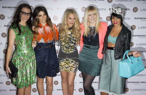 Parade arrive for the Pre-Brit Awards Dinner at a London venue, Thursday, Jan. 26, 2012