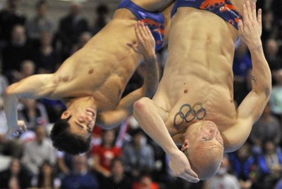 Mears and Robinson Baker of Britain dive during the Men039s Synchronised 3m Springboard preliminary round at the FINA Diving World Cup in London