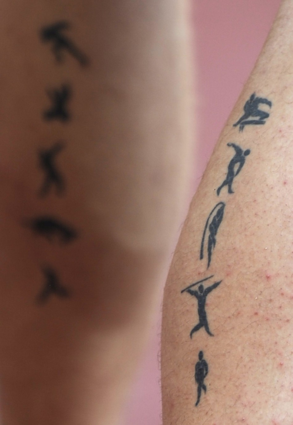 Pictogram tattoos of the decathlon are seen on the legs of Krauchanka of Belarus during the athletics competition in the National Stadium at the Beijing 2008 Olympic Games