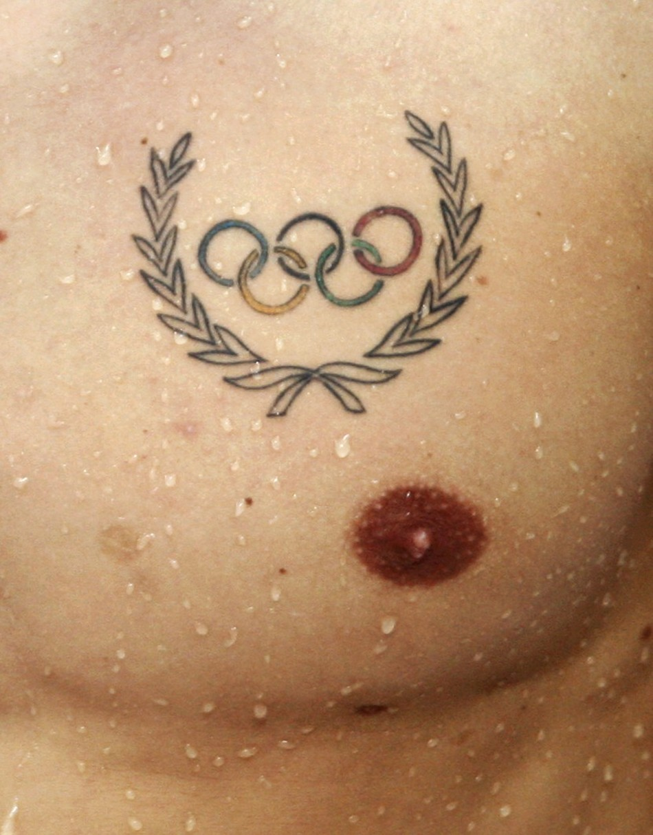The Olympic logo is tattooed on the chest of a swimmer ahead of the Beijing 2008 Olympic Games