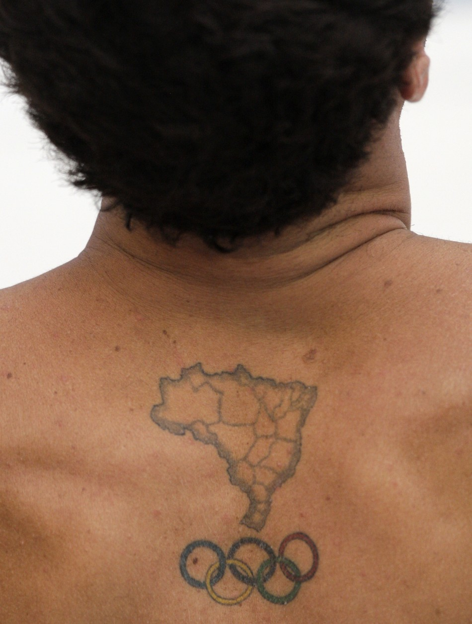 A tattoo in the shape of Brazil is seen in the back of Parisi of Brazil during his 10m diving platform practice session for the Beijing 2008 Olympic Games