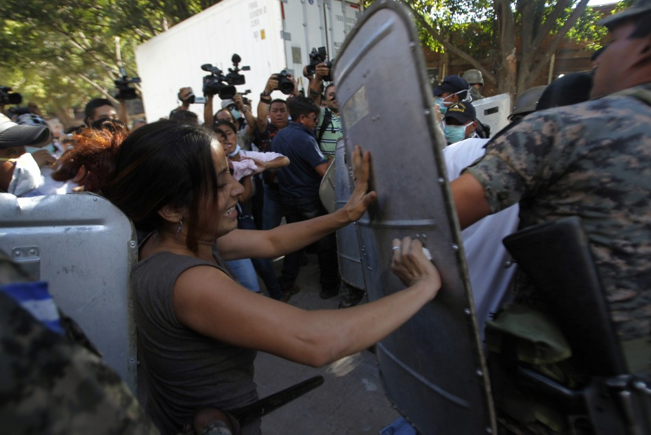 Relatives of the prison fire victims clash with police as they try to enter a morgue to identify bodies. (Reuters)