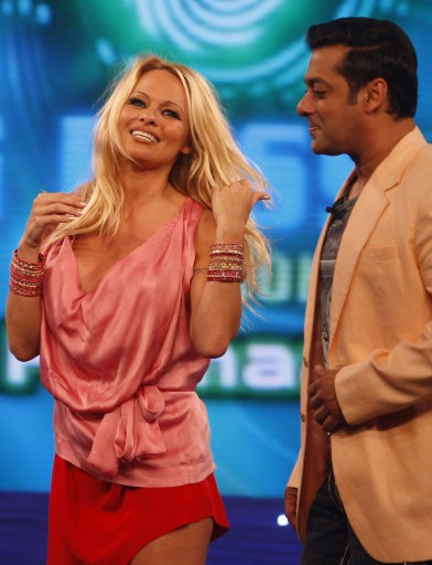 Former quotBaywatchquot star Pamela Anderson, left, gestures as Bollywood actor Salman Khan looks on, on the sets of the Indian reality television show quotBig Bossquot in Mumbai, India