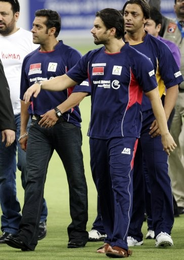 Bollywood actors Salman Khan, right, Sohail Khan, center, and Shoiab Akhtar, left, are seen at the Sportscity ground, before the start of a celebrity cricket match